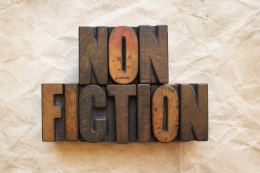 The word Nonfiction written in vintage wood letterpress type.